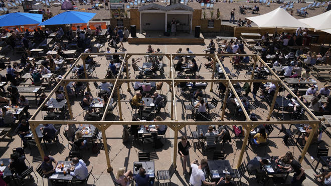 People packed Brighton's seafront yesterday enjoying new freedoms in the sunshine after lockdown measures were eased
