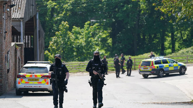 Armed police at Hallington House Farm on the outskirts of Louth, Lincolnshire