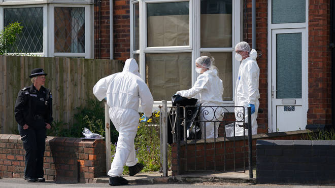 Forensics officers in Lincolnshire after the deaths of a woman and child