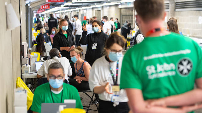 Workers at a major vaccination event at Twickenham Stadium yesterday