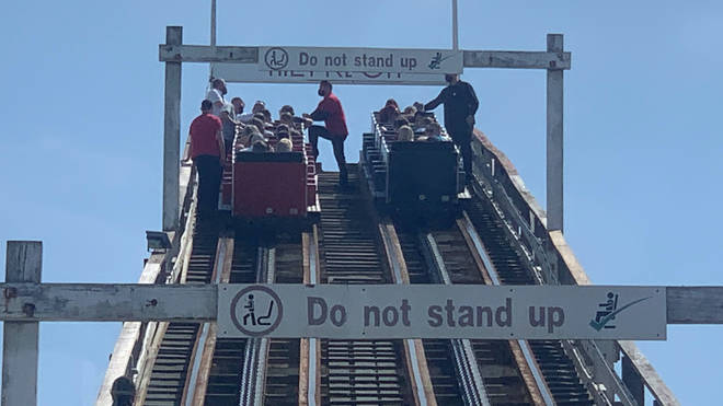 Riders were rescued after the Grand National rollercoaster failed part way up a slope