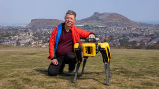 Professor Yvan Petillot with the robot