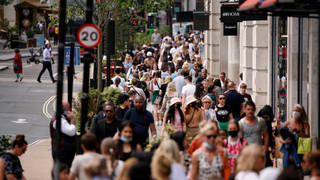 Crowds filled the street to enjoy the sun on the hottest day of the year.