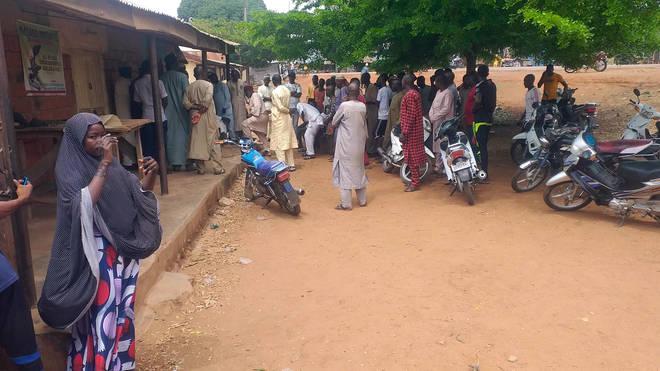 Parents wait for news at Salihu Tanko Islamic School