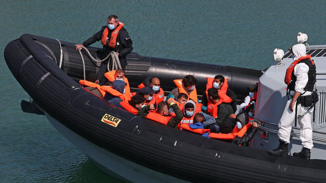 A group of people thought to be migrants are brought in to Dover, Kent, on Thursday