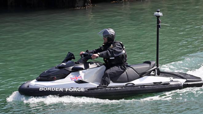 A Border Force officer arrives on a jet ski into Dover