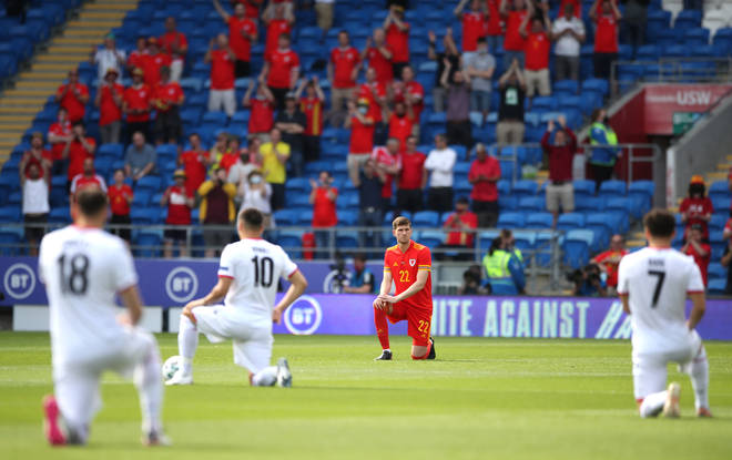 Wales' Chris Mepham takes the knee prior to their game against Albania on Saturday.