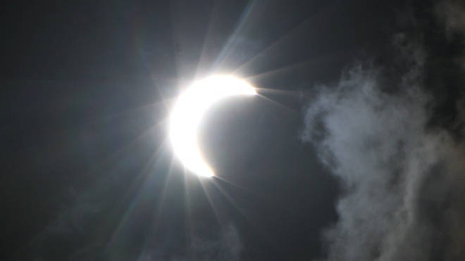 A partial eclipse is caused when the Moon passes between the Earth and the Sun