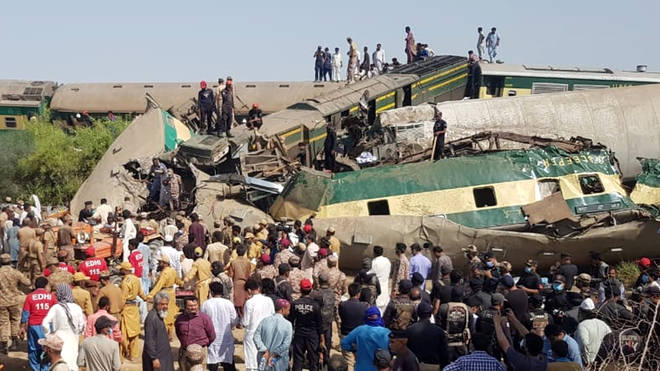 Crowds gathered at the scene of the collision in Pakistan