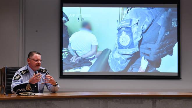 Australian Federal Police deputy commissioner Nigel Ryan speaks to the media