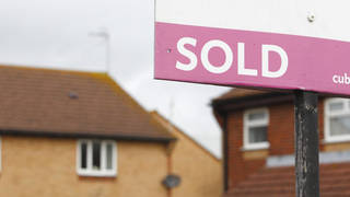A sold sign outside houses