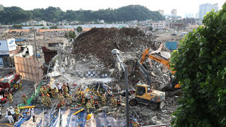 Firefighters search for survivors in a collapsed building in Gwangju, South Korea (Chung Hoi-sung/AP)