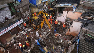 Rescuers clear debris after a building collapsed in Mumbai