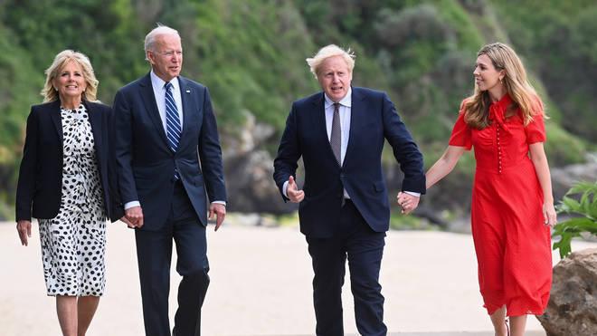 Boris Johnson, Joe Biden, Carrie Symonds and Dr Jill Biden were pictured in Carbis Bay in Cornwall.