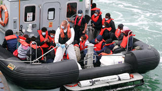 A group of people are brought to shore in to Dover