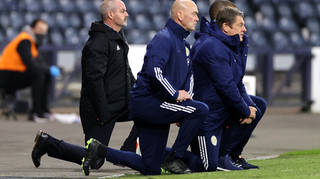 Scotland manager Steve Clarke (left) takes a knee in support of the Black Lives Matter movement before the UEFA Nations League game last year