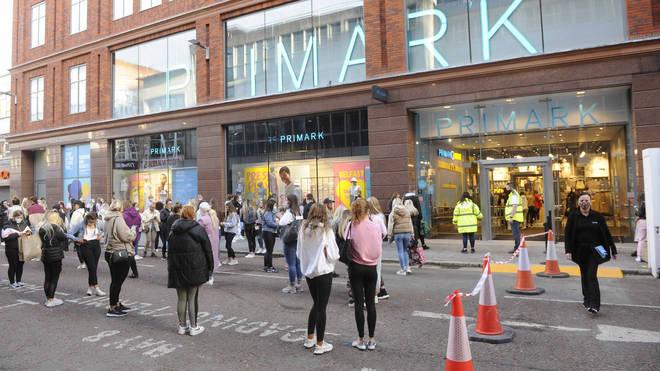 People queue at a Primark shop