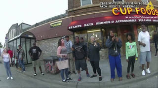 Bystanders including Darnella Frazier, third from right filming, as Derek Chauvin pressed his knee on George Floyd's neck