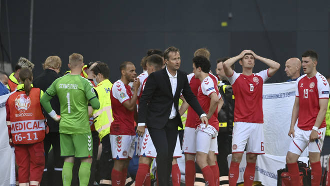 Players waited anxiously as medics went to help Eriksen