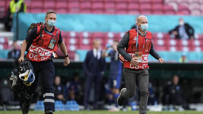 Medics scrambled to help the midfielder