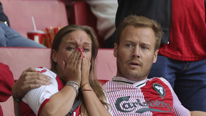 Distraught fans looked on as Eriksen received treatment