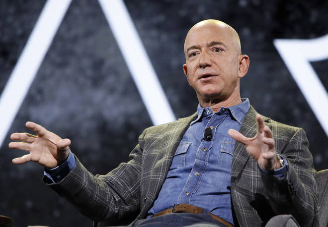 Jeff Bezos and his brother will fly into space in July with the mystery bidder