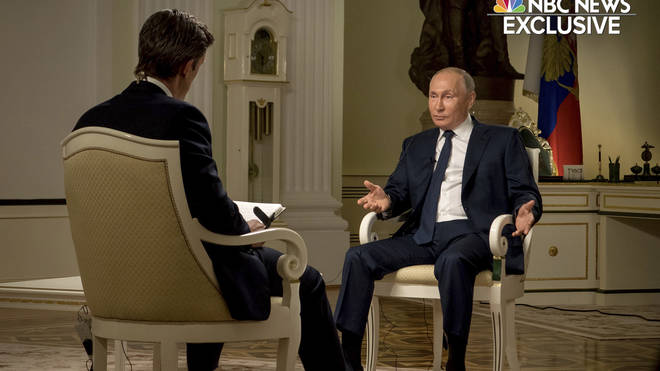 NBC News journalist Keir Simmons, left, speaks with Russian President Vladimir Putin