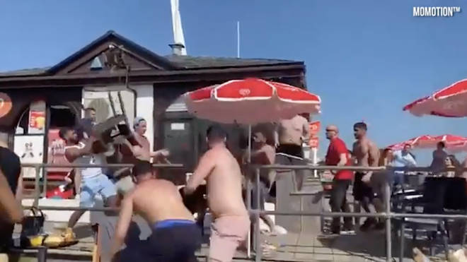 Deckchairs and glass bottles were thrown throughout the fight.