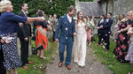 Mr and Mrs Bone, Lucy and James, pictured at their wedding in May with 30 people present