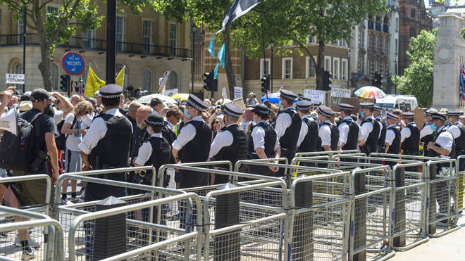 A line of police at the anti-lockdown protest at Downing St on Monday