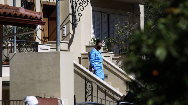 A Greek man has confessed to the murder of his British wife in Athens in their home
