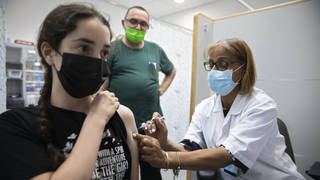 A woman receiving a vaccination