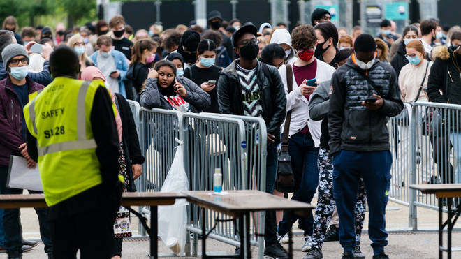 People queue for a vaccine outside the London Stadium