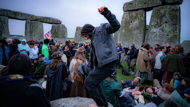 People inside the stone circle during Summer Solstice at Stonehenge