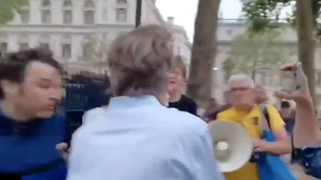 The journalist was forced to run to safety after being hounded by a mob
