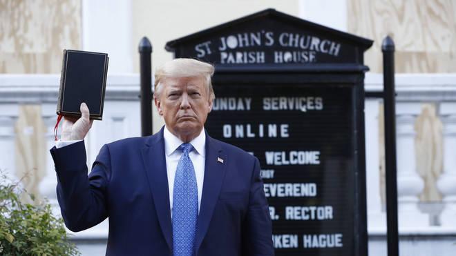 Donald Trump holds a Bible outside St John's Church