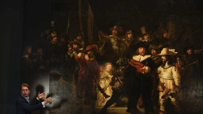 Museum director Taco Dibbits with Rembrandt's Night Watch