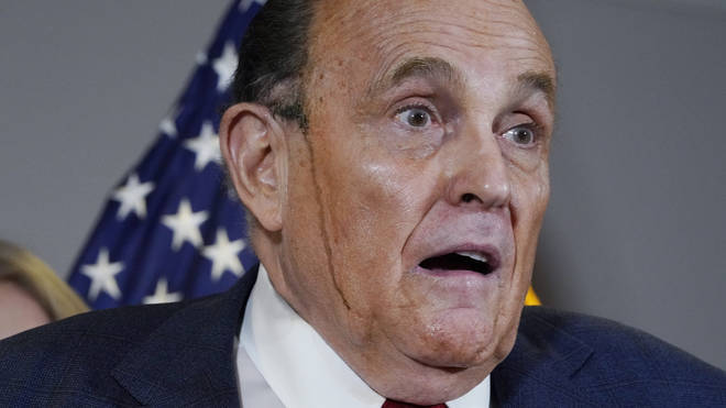 Rudy Giuliani's hair dye stole the show at one press conference after it melted in streaks down his face.