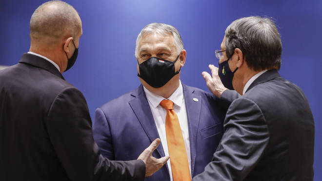 Hungary's Prime Minister Viktor Orban, centre, talks to Bulgaria's President Rumen Radev, left, and Cypriot President Nicos Anastasiades during an EU summit at the European Council building in Brussels
