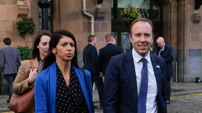 Matt Hancock walking with Gina Coladangelo during the 2019 Tory Party conference