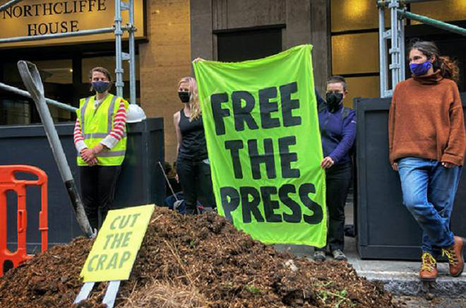 Extinction Rebellion activists dumped tonnes of manure outside the offices of the owners of the Daily Mail
