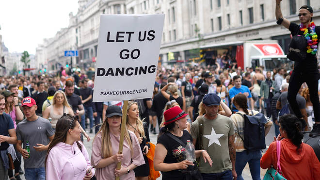 """Thousands have joined the """"Freedom to Dance"""" protest in central London"""