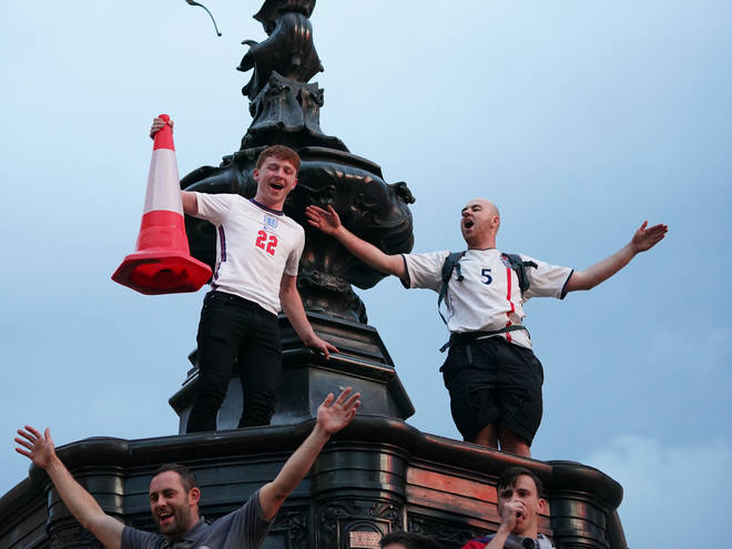 England supporters climbed up on to the Shaftesbury Fountain in Piccadilly Circus