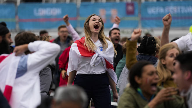 An England fan celebrates during the side's 2-0 win