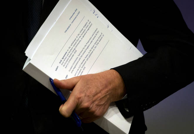 Michel Barnier holds the draft EU withdrawal agreement