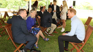 Prince Harry met WellChild award winners prior to the unveiling of his mother's statue on Thursday.