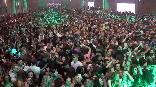 A crowd parties at a nightclub pilot event in Liverpool