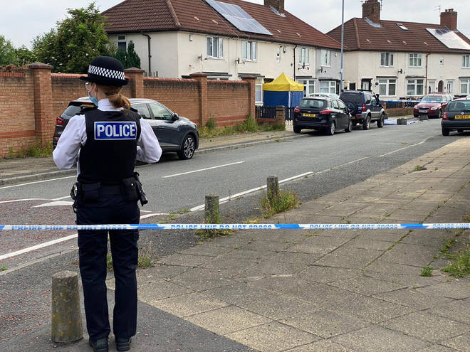 Police taped off a residential street in Huyton after the shooting