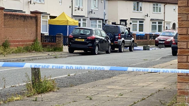 A man has been shot dead in a residential area on Merseyside