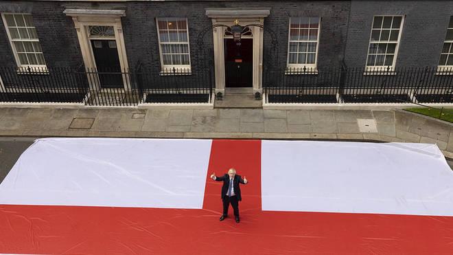 Boris Johnson poses with giant England flag ahead of Saturday's Euro 2020  clash vs Ukraine - LBC